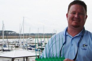 Chris Ferguson, General Manager of Morningstar Marinas at Golden Isles, with the green, tamper-proof seals, which he and his staff are responsible for attaching to the head valves after each pump-out. The marina must maintain pump-out records for each applicable liveaboard vessel.