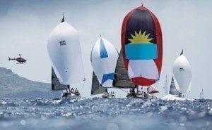 Hugo B proudly flies the flag of Antigua on her spinnaker. Photo: Paul Wyeth/Antigua Sailing Week