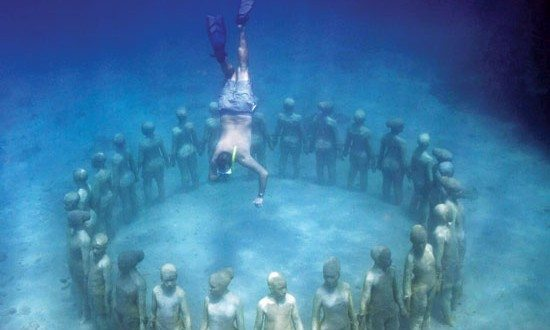 Vicissitudes is the signature sculpture in the park and honors the diverse ethnic backgrounds of the children of Grenada. Photography courtesy of Scuba tech