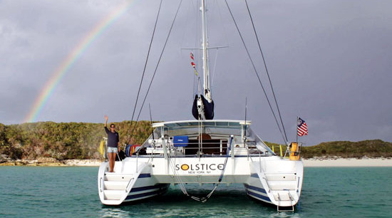 Charter in the Bahamas - Liza at the stern. Courtesy Catamaran Solstice