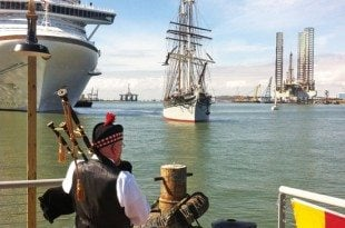 Elissa is welcomed back from the shipyard by a bagpiper. Photo by Jamie White, Director of the Texas Seaport Museum
