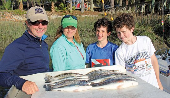 Capt. Matt Williams Inshore specialist with Miss Judy Charters, Chris Waters her son Will and Oliver Howell.