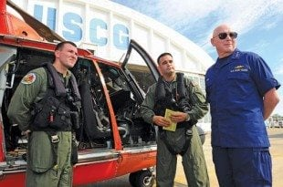 USCG Press Officer, Lt. Hector 'Rafy' Ramos (center) and USCG Commandant, Admiral Robert Papp (right) at Air Station Borinquen in Aguadilla, Puerto Rico. Photo courtesy of USCG
