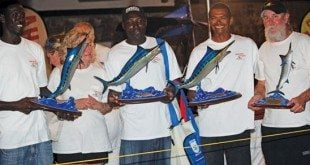 Captain Mike Pigott (second right) and crew, winners of the Antigua & Barbuda Sport Fishing Tournament Marlin Division. Courtesy of Antigua and Barbuda Sport Fishing Tournament