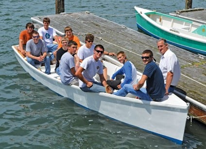 To The Moon was christened and launched Monday, June 3 by ECHS boatbuilding class in Beaufort. Bow to Stern: Left side, seated are: Cameron Lewis, John Chadwick, Joseph Lewis, Dallas Brewer, Trey Hall, Harlan Collins. Right side, Heber Guthrie, Ryan Van Kouteren, Trey Russel, Nick Hancock, Cayton Daniels. Photo by Helen Aitken