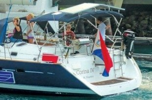 Corina IV, carrying the flag of Sint Maarten proudly around the world