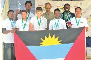 Awards ceremony 15th BVI Premier's Cup International Youth Regatta, back row, from left: Janield Smith; Dr. the Hon. Daniel Orlando Smith, Premier of Tortola; and Karl James, head coach at the Antigua Yacht Club. Front row: Stephon Dundas, Jules Mitchell, Lewis Fitzerald, Rhone Kirby and David Jackson. Photo courtesy Kids and the Sea BVI