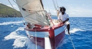 Crewman Brennon Gumbs on the bow of Tradition. Photo: Justin Sihera