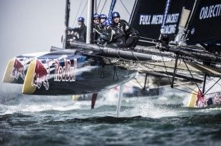 Team members of Objective Australia perform during the speed trial of the Red Bull Youth America's Cup in San Francisco, California on August 31, 2013.