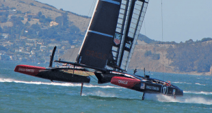 Skimming on hydrofoils fixed to carbon fiber hulls, Oracle Team USA flies their 72-foot catamaran, powered by winds against the fixed, rigid wing sail, above the San Francisco Bay. Photo by Kathy Bohanan Enzerink