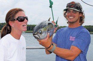 McKenzie Hutaf can't wait for sushi from John Crislip's blackfin tuna. Photo By Jeff Dennis
