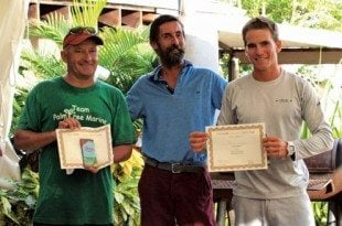 Overall race winners Kenzo Szyjan (right) and Mike Bingley (left) receive award certificates and prizes from David Royce, PCYC's Vice-Commodore & Race Committee Chairman