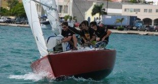 The USA's Chris Poole and team race hard downwind to get in front of their opponent. Credit: Dean Barnes