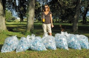 Trish Cronan, President of the Caribbean Yacht Brokers Association showing water bottles saved from landfills by charter yachts using their own water or reusable bottles