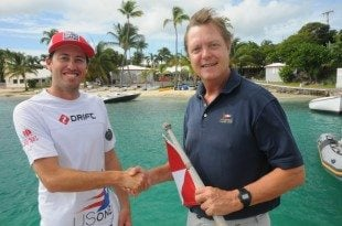 L to R: Taylor Canfield, Virgin Islands Sailor of the Year for 2013, Phillip Shannon, President of the Virgin Islands Sailing Association, with the iconic St. Thomas Yacht Club in the background. Credit: Dean Barnes