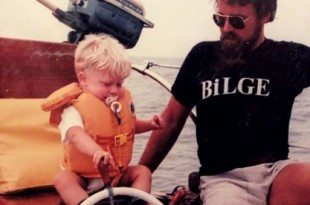 Andy, with his dad Dennis at the helm of 'Tzigane' at a very early age!