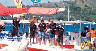 The crew of the winning J24 Attitude begin their victory celebrations