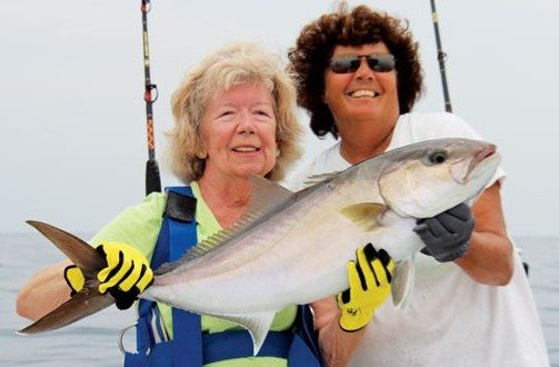 """It took a good 15 minutes of line stretching, but Jan Guidage landed her amberjack! Captain Brown said, """"The fish was a strong fighter, but Jan still managed it all by herself!"""""""