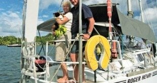 Alvah and Diana Simon and their cat 'Halifax of the Arctic' aboard their boat, Roger Henry, in Micronesia.