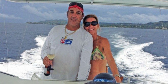 Captain Gerard and his wife share the helm