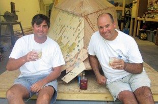 Ed Roberson and co-worker, Chris McGhee celebrate the whiskey plank on the port side. Photo courtesy of Ed Roberson