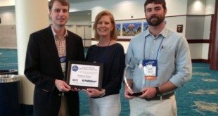 Thad Moore, Preston Development Company VP of Finance, Hank Whitley, Southport Marina Manager and Vanessa Jenkins, Preston Development Company VP with the 2013 Large Marina of the Year Award.