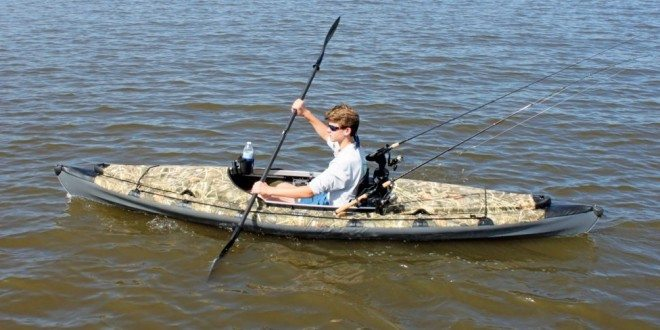 Intern David Grubbs pilots his Folbot in the Ashley River. Photo by Jeff Dennis