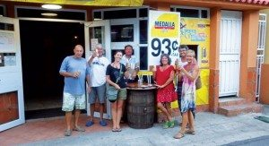 You can't beat the price! Cruisers enjoy Medalla beer at one of the local bars. Photo by Rosie Burr