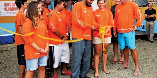 Brian Deher, president of the St. Maarten Marine Trades Association (far right) and Garth Steyn (second right) look on as youngsters from Kidz At Sea cut the ribbon at the opening of their new clubhouse. Photo: OceanMedia