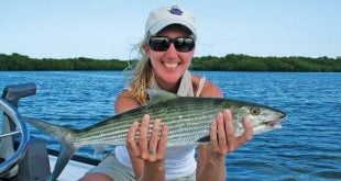 Shirley Wilson catching a Bonefish in Islamorada, Florida Keys with Captain Ted Wilson. Photo courtesy of CaptainTedWilson.com