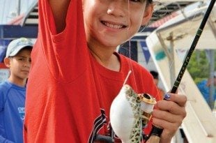 Kamryn Redlin catches a puffer fish