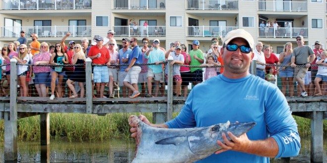 Wes Frierson and his huge wahoo that suffered a shark bite. Photo By Jeff Dennis