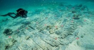National park archeologists survey the newly exposed wreck of the HMS Fowey. Photo courtesy of the National Parks Service