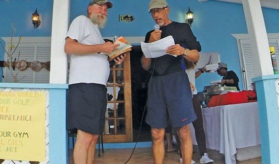 Champion Male Angler Glen Irish (left) receives his winnings from Dr. Kelvin Charles. Photo: Kimberley Hall