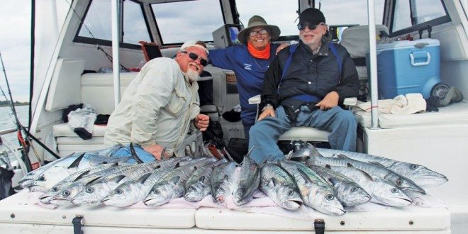 Christopher Miller, Captain Judy Helmey, and David Miller…These fishermen are showing off a fine catch of winter king mackerel, little tunny, and barracuda! Photo by Captain Judy Helmey