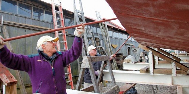 Docent volunteers: Lloyd Devigne, left, and Frank Garahan, right, apply bottom paint to the Winnie Estelle. During the warmer months, volunteer USCG certified captains and their crew take passengers out on the Miles River for scenic cruises aboard the historic buy boat from the Museum's waterfront. Photo by Tracey Munson
