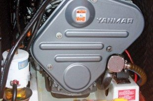 Yanmar diesel engine with Primary Filter on the left and Raw Water Intake and Impeller Housing on the Right
