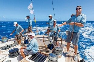 Crew work on Swan 80 SELENE (CAY) during Day 3 of racing. Photo: Rolex / Carlo Borlenghi