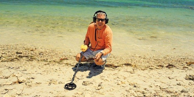 Author walks along North Vero beach scanning for treasure. Photo by Rafael Lima