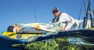 Tournament champion Brian Nelli with his dolphin fish. Photo by Jorge Bustamante