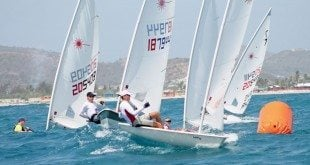 The fleet rounds the windward mark during the 26th Heineken Light Caribbean Open Laser Championships held in Orient Bay, St. Martin, on June 13-14. Photo Robert Luckock