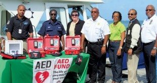 AED Fund gives new AEDs to St. Croix, VI (from left): Sean Santos, VIPD/Marine/Training; Jason Henry, St. Croix Rescue Field Ops/Marine; Cher Will, AED Fund; Howard Forbes, Sr., DPNR Police/Environmental Enforcement;- Shauna Richards, Office of Sen. Sanes; -Mark Corneiro, VIPD Act. Deputy Chief, and Modestus John-Baptiste, St. Croix Rescue Asst. Chief.