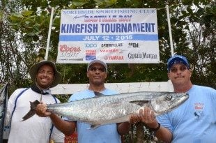 Thierry Williams (center) caught the tournament's Largest Kingfish, a 31.55-pounder, aboard Oceanna. Fellow anglers James Williams (left) and Albert Brin (right). Credit: Dean Barnes