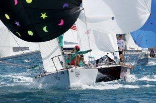 Grenada Sailing Week: The J24 Glory Daze is ambushed by eventual class winner Island Water World Die Hard. Photo: Tim Wright