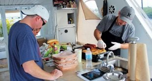 Food Yacht: Chef Lindemann, owner of Food Yacht, preparing lunch. Photo courtesy of Food Yacht