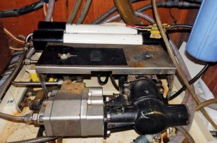 Water Maker: Our water maker removed from its snug position under the sink and looking a bit sorry for itself prior to overhaul. Photo by Sim Hoggarth