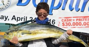 Nine-year-old Robbie Richards with his winning 29.4-pound dolphin fish (mahi-mahi). Credit Dean Barnes