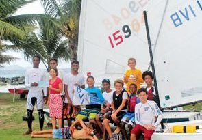 Charter Yacht : Janet Oliver presents a cheque to the BVI sailors after their race training session. Photo: Royal BVI YC / Clair Burke