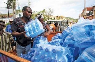 PADF staff deliver clean water to families affected by Hurricane Matthew in Cavaillon, Haiti