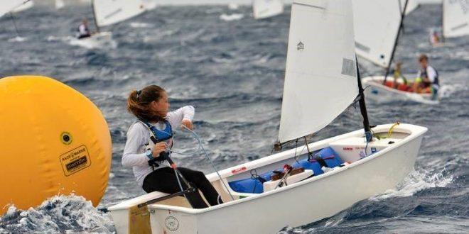 Photo: St. Thomas Yacht Club's Mia Nicolosi, winner of the 2016 International Optimist Regatta, presented by EMS Virgin Islands, shows her racing prowess on the water. Credit: Dean Barnes